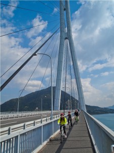 Cyclists cross the Tatara Ohashi Bridge, one of several engineering marvels spanning the length of the Shimanami Kaido bike route. (c) GTH & Nathan DePetris
