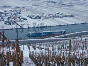 The AmaCello sails past Piesport on Germany's Moselle river. Passengers can visit several Christmas market during the holiday season. (c) GTH & Nathan DePetris